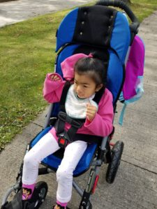Getting ready for school, in adaptive stroller