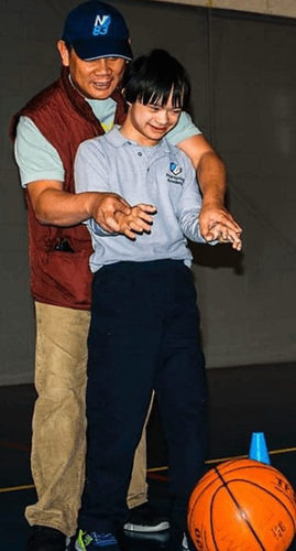 Down syndrome boy with dad
