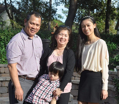 Down syndrome boy with family